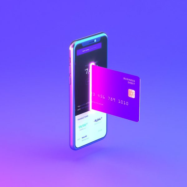 A mobile phone with a card going into it representing online banking